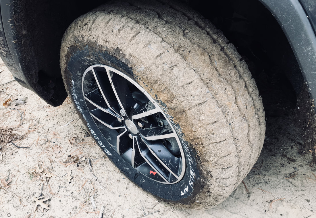 Bridgestone Dueler A/T REVO 3 tread packed with sand