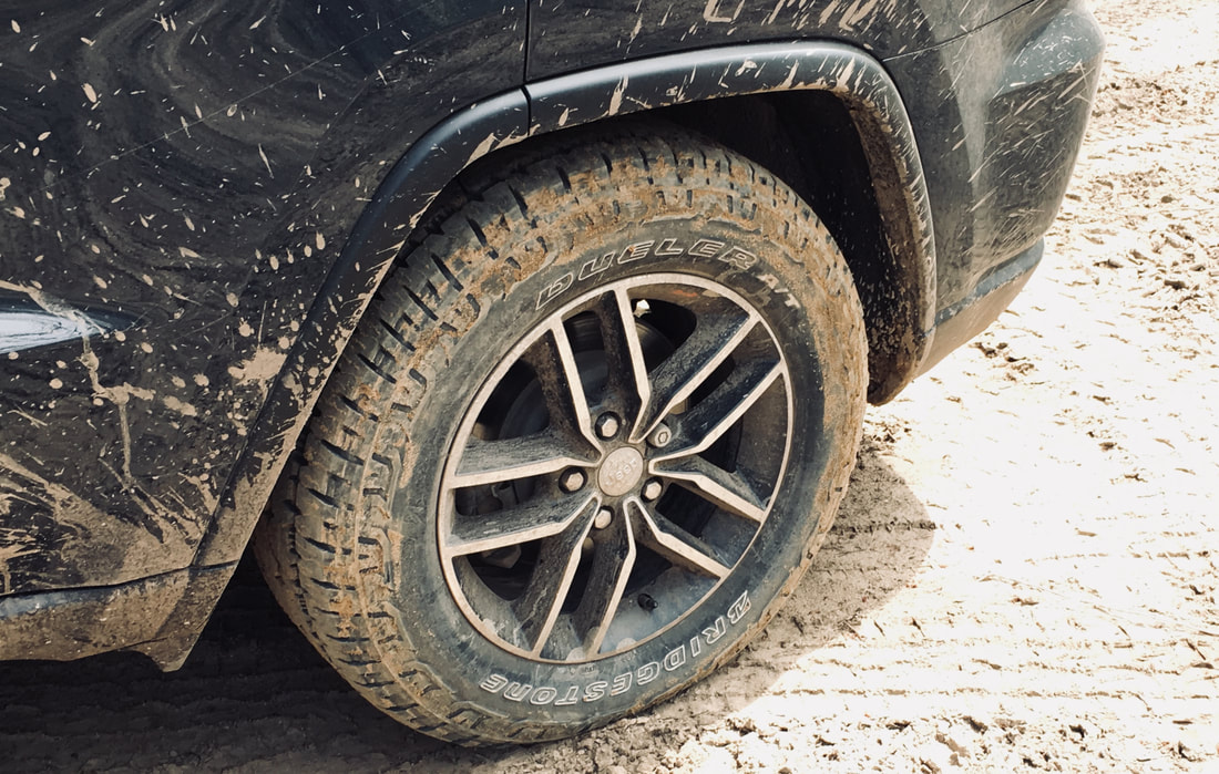 Bridgestone Dueler A/T REVO 3 in dirt off-road